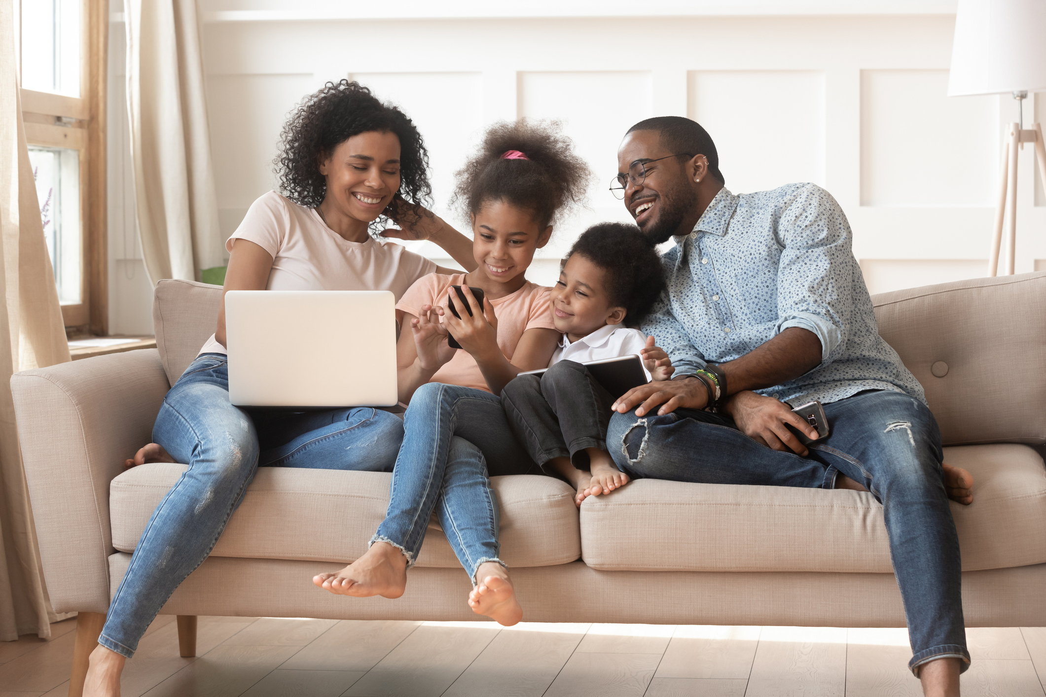 family sitting on the couch