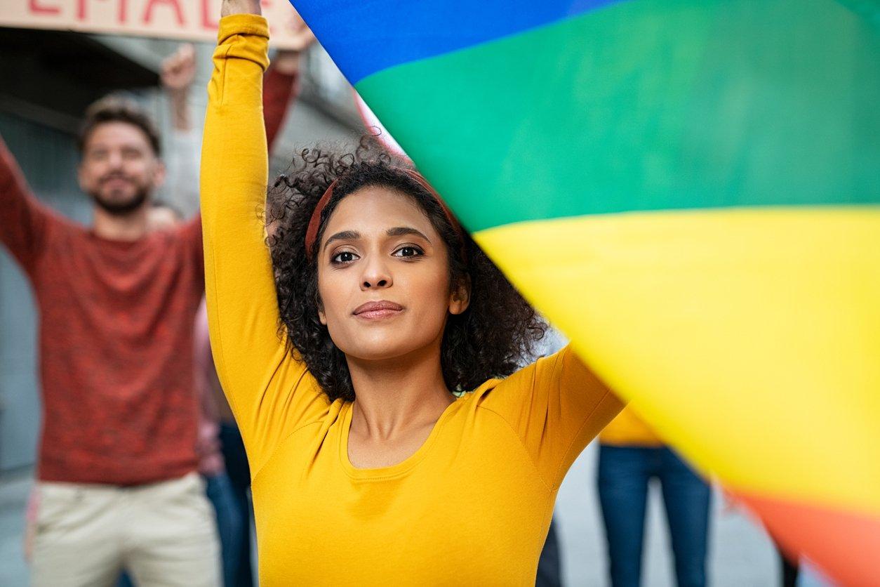 WomanHoldingRainbowFlag