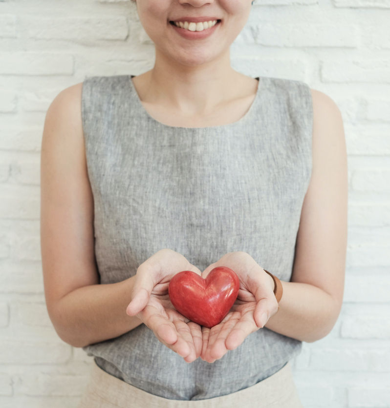 woman-holding-a-heart-in-her-hands