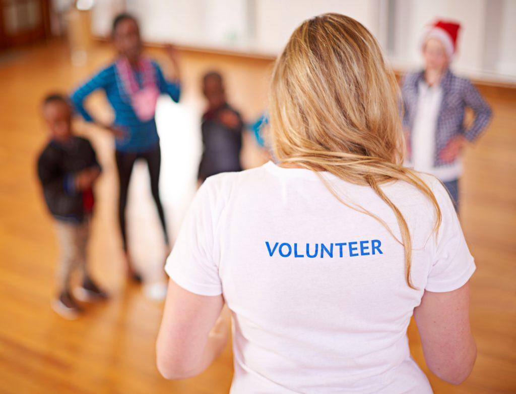 Volunteer working with children